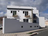 Nautilus Apartments in the Canary Islands take their shape from the bow of a ship to make best use of their corner site.