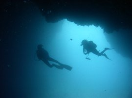 A diver examines the beams exposed in a recent storm