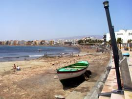 The beach at Arinaga is a popular destination for Spanish families at the weekend
