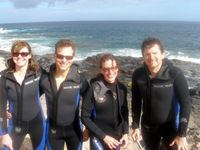 Members of the Philadelphia Orchestra smile after their dives in Gran Canaria