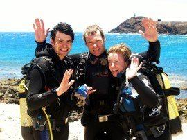 Celebrating after their first dive in the Marine Reserve in Gran Canaria