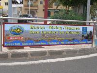 Our sign is on the Left of the roundabout, in front of the Petrol Station in Arinaga
